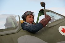 Richard Minney from the Allied Assortment re-enactment, in the cockpit of a replica Spitfire, Wartime in the Vale 2015